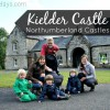 Kielder Forest and Castle with Regatta all-in-one toddler waterproof suits
